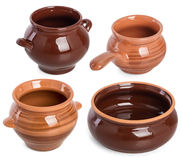 Clay pots isolated on white background. Brown small clay pots for food, isolated on white background Stock Images