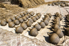 Clay pots (jars) drying in the sun on pottery square in Bhaktapur in Nepal Stock Photography