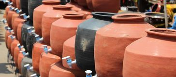 Clay pots. Modern clay pots with taps fitted in to it Stock Image