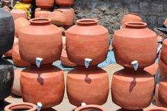 Clay pots. Modern clay pots with taps fitted in to it Stock Photos