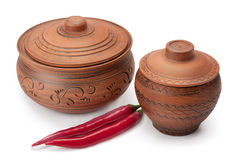 Clay pots and peppers Stock Photos