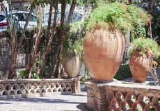 Clay pots with plants on Entrance of famous park Parco Colonna Villa Comunale in Taormina, Sicily, Italy royalty free stock photo