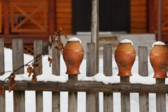 Clay pots put up on a wooden fence Royalty Free Stock Photography