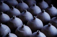 Clay pots ranking. The hand made clay pots were ranking tidily Stock Photography
