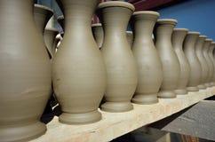 Clay pots on the shelf Royalty Free Stock Photos