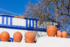 Clay pots stand on white pottery wall in Portugal Royalty Free Stock Photos