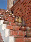 Clay pots standing on stairs Stock Photos