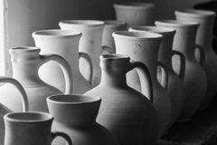 Clay pots and vases of different sizes. Close up Royalty Free Stock Photo
