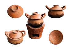 Clay pots on white background. Clay pots and old charcoal on white background Stock Photography