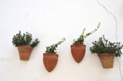 Clay pots on white wall Royalty Free Stock Photo