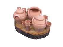 Clay pots on wooden support isolated over white Stock Photo