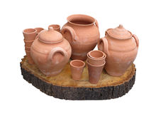 Clay pots on wooden support isolated over white Royalty Free Stock Images