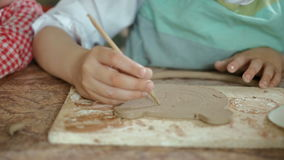 Clay potter hands wheel pottery work workshop teacher and girl pupil 4k stock video