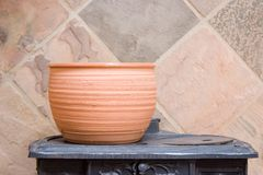 Clay Pottery againts stone. Clay pot standing on antique stove against nice stone tile background. Canon EOS 20D ISO100 Stock Photo