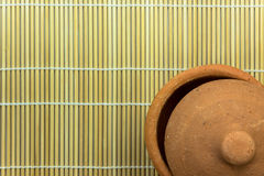 Clay pottery on bamboo mat Stock Photo
