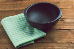 Clay pottery plate on the wooden table. toning Royalty Free Stock Image