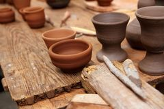 Clay pottery potter handcrafts on vintage table Stock Image