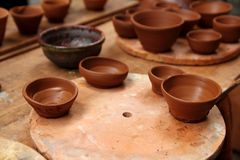 Clay pottery potter handcrafts on vintage table Royalty Free Stock Photo
