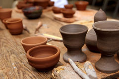 Clay pottery handcrafts on vintage table Royalty Free Stock Images