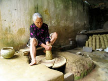 Clay pottery woman Stock Image