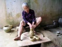 Clay pottery woman Stock Photo