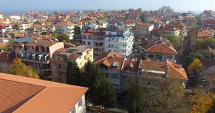Clay red roofs of the old part of Pomorie in Bulgaria stock footage