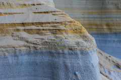 Clay, rock and sand in layers. Clay, rock and sand on a cliff in BC Canada Stock Photos