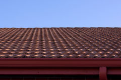 Clay roof and blue sky. Against a blue sky is a typical Florida clay roof with gutter and drain pipe Royalty Free Stock Photos