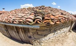 A clay roof of a rural building in the mountain village of Zheravna, Bulgaria. Mountain eco-village Zheravna - Bulgarian national carpet center, rural tourism stock photo