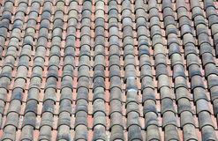 Clay Roof Tiles. Old clay roof tiles in a row Royalty Free Stock Photo