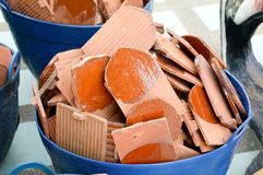 Clay roof tiles on plastic basket. Close up clay roof tiles on plastic basket Stock Image