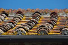 Clay roof tiles of traditional building. Traditional roof tile with tiles and cement and plaster of historic urban or rural building Stock Photography