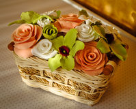 Clay roses and orchids in little basket Royalty Free Stock Photo