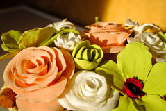 Clay roses and orchids in little basket Royalty Free Stock Images