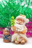 Clay Santa Claus and bear Stock Photo