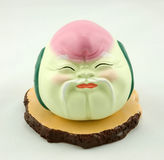 Clay sculpture. A Peach-Shaped old man clay sculpture Stock Image