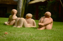 Clay sculptures on the grass Stock Images