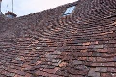 Clay shingle roof with window Royalty Free Stock Image