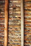 Clay square roof tiles ceiling indoor wooden beams Royalty Free Stock Image