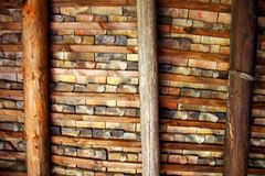 Clay square roof tiles ceiling indoor wooden beams Stock Photo