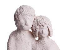 Clay statue of a couple. Isolated on white Royalty Free Stock Image