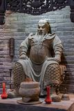 Clay statue of General Guan Yu at an altar. A clay statue of General Guan Yu sitting a top an altar in his honor Royalty Free Stock Images
