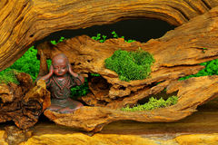 Clay statue of a little monk praying Royalty Free Stock Photo