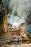 Clay stove with burning wood Stock Photo