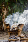 Clay stove with burning wood Stock Image