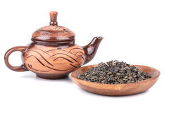 Clay tea kettle and dry tea leaves Royalty Free Stock Image