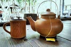 Clay tea kettle and mug Stock Photography