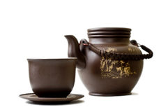 Clay tea set. A tea set consist of teapot, cap and saucer made of clay isolated on white stock photography
