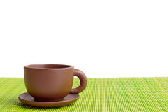 Clay teacup. On the mat isolated on white Stock Photos