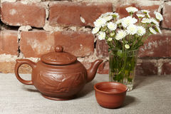 Clay teapot and bowl Royalty Free Stock Image